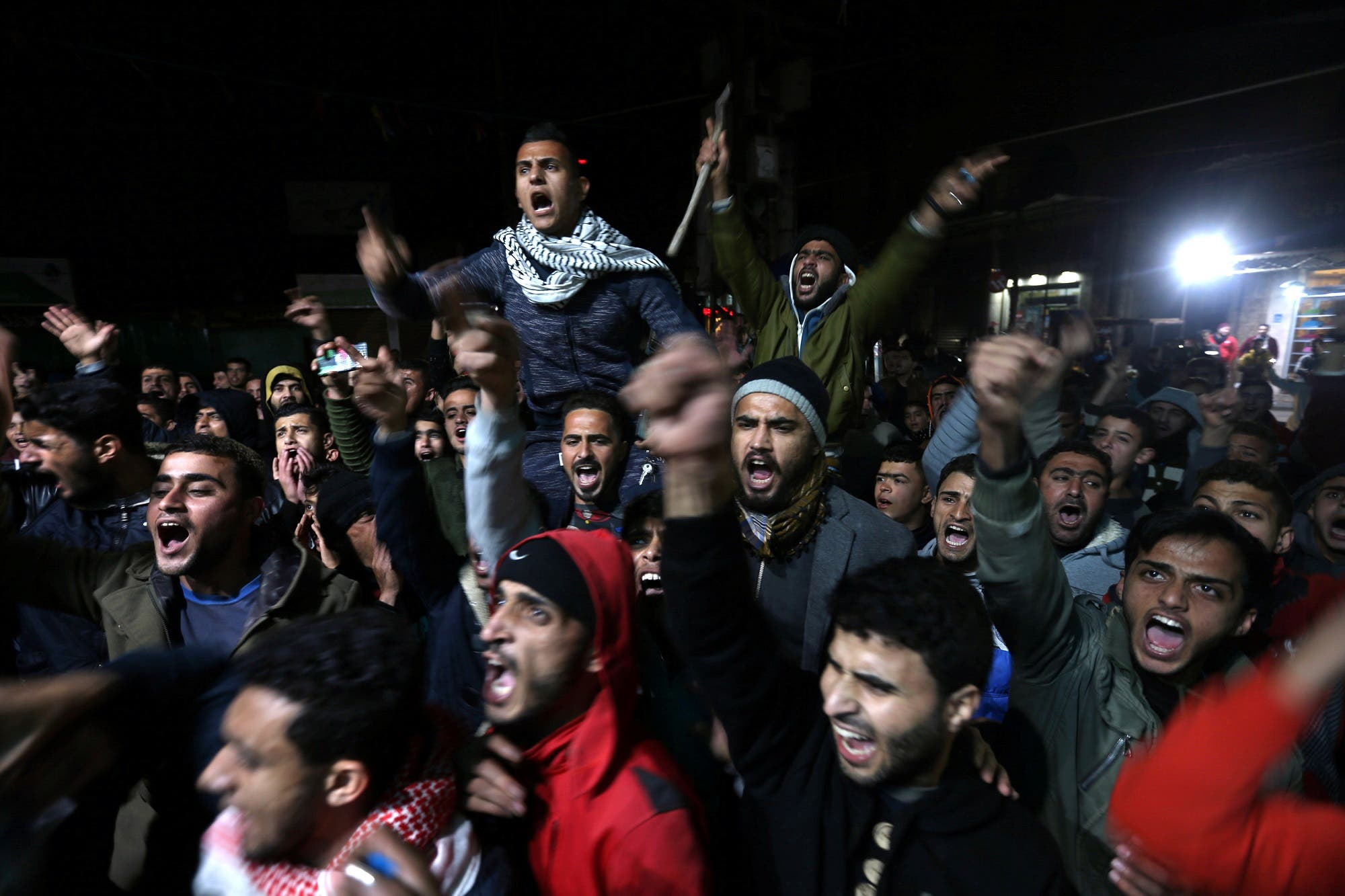 Palestinians react during a protest in Khan Younis in the southern Gaza Strip on December 6, 2017. (Reuters)