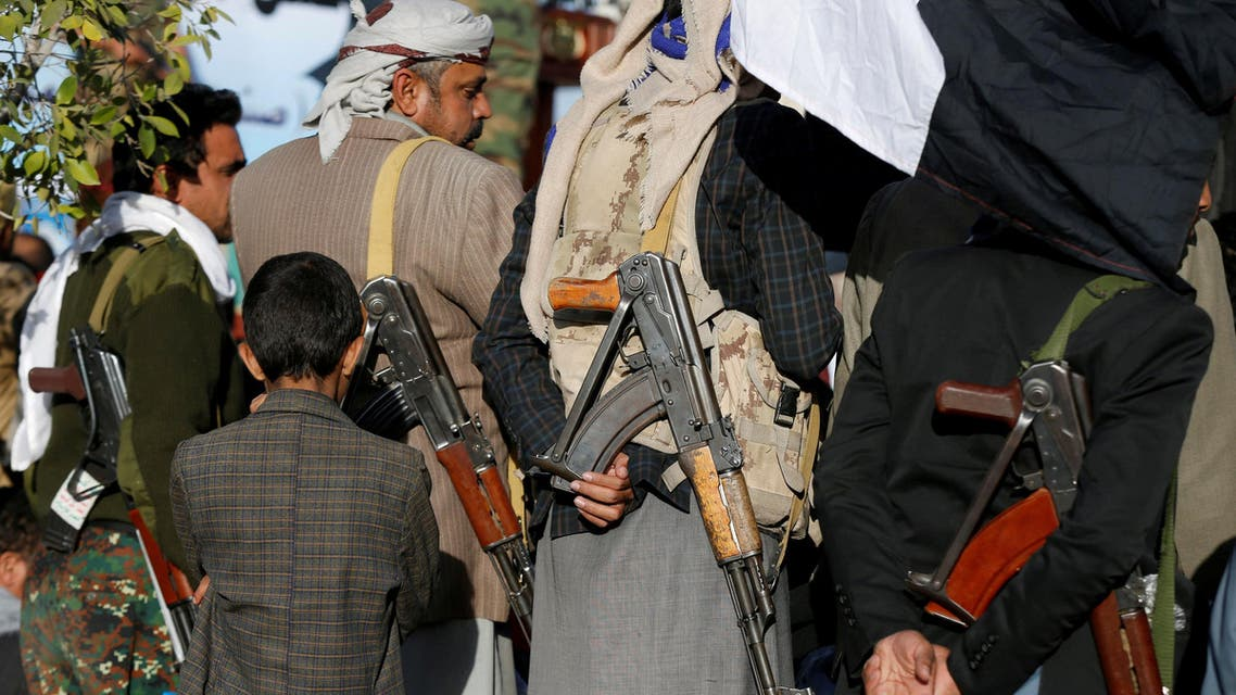A boy stands behind armed Houthi followers attending a rally to celebrate the killing of Yemen's former president Ali Abdullah Saleh in Sanaa, Yemen December 5, 2017. REUTERS/Khaled Abdullah TPX IMAGES OF THE DAY