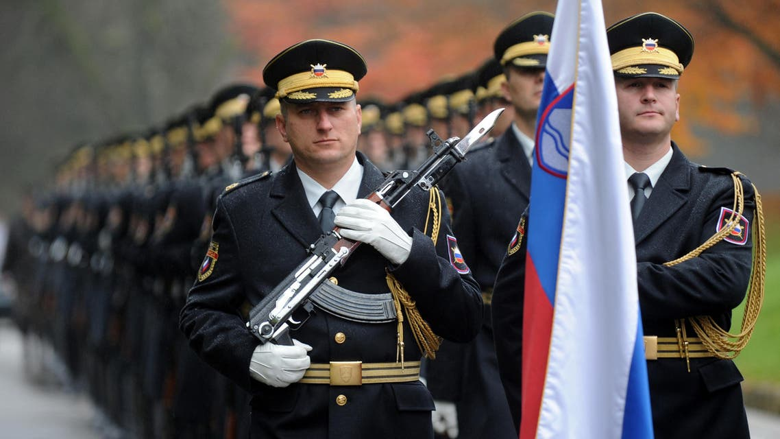 Slovenian Army honour guards march as they prepare for their inspection before the meeting of Slovenian President Danilo Turk and his Romanian counterpart Traian Basescu (not pictured) in Brdo, some 50 kilometers from Ljubljana, on November 3, 2010. Basescu arrived for an official two-day visit to Slovenia. AFP PHOTO/ HRVOJE POLAN HRVOJE POLAN / AFP