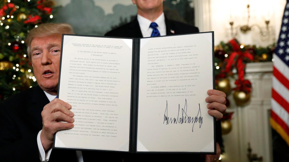 With Vice Pence Mike Pence looking on, U.S. President Donald Trump displays an executive order after he announced the U.S. would Jerusalem as the capital of Israel, in the Diplomatic Reception Room of the White House in Washington, U.S., December 6, 2017. REUTERS/Kevin Lamarque