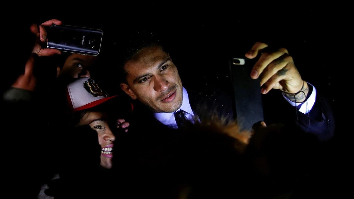Captain of Peruvian national soccer team Paolo Guerrero poses for a selfie with fans after a hearing at the FIFA Disciplinary Committee in front of FIFA's headquarters in Zurich, on November 30, 2017. (Reuters)