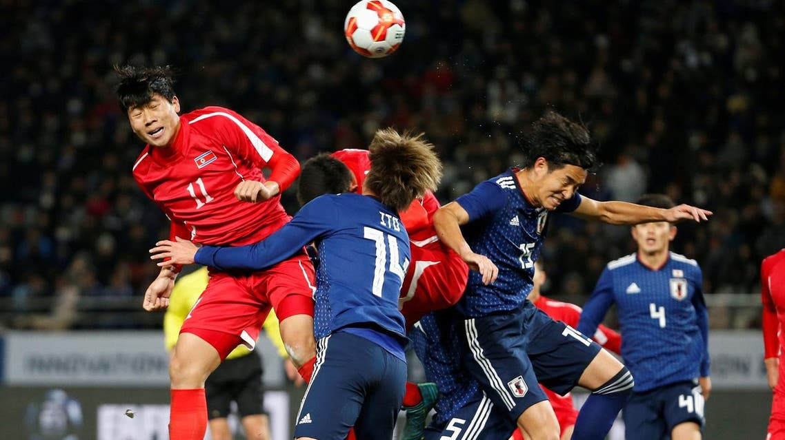 North Korea's Jong Il Gwan and Japan's Junya Ito and Mu Kanazaki in action during  the East Asian Football Championship in Tokyo on December 9, 2017.  (Reuters)