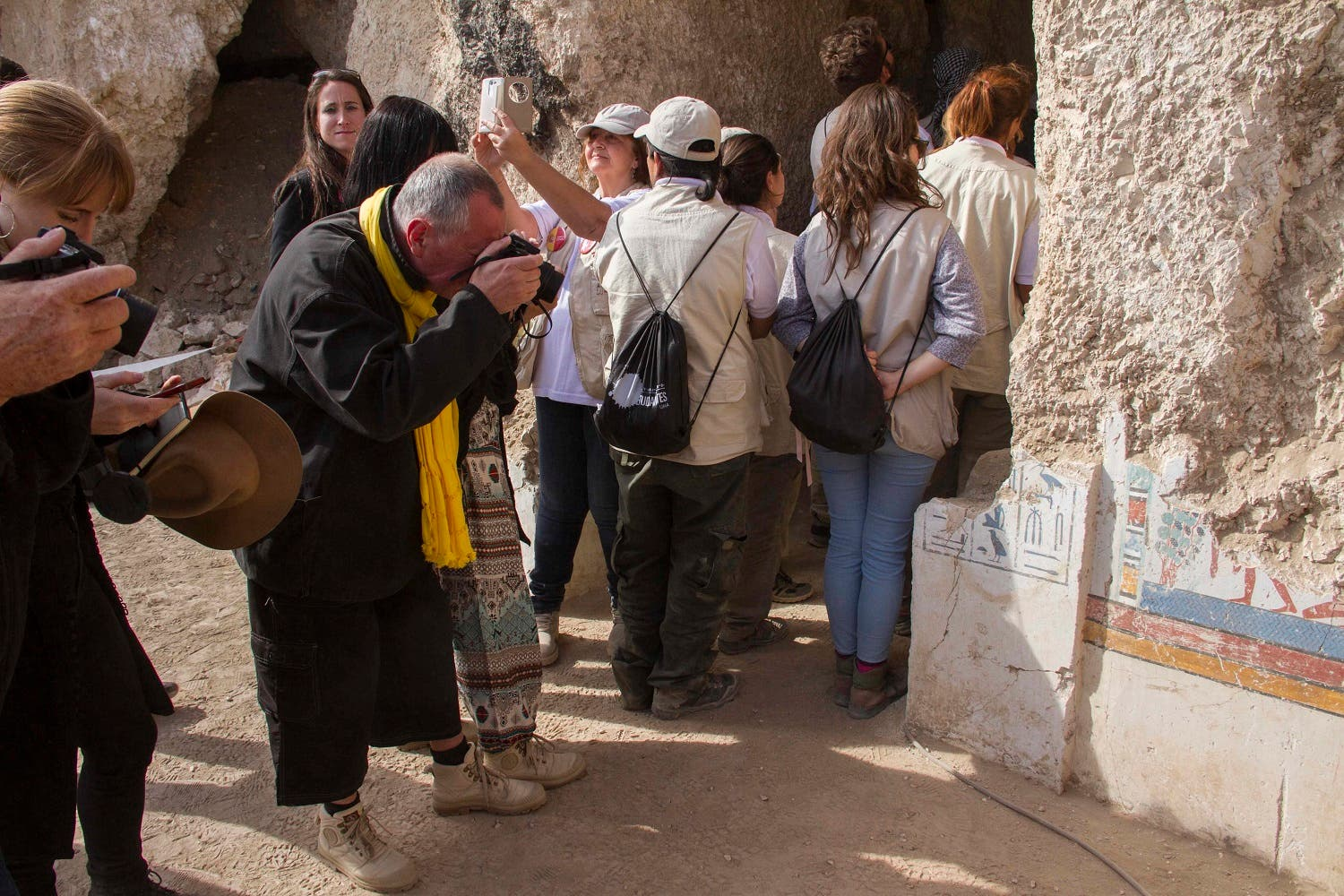 Tourists photograph an entrance of a newly discovered tomb on Luxor's West Bank during an announcement for the Egyptian Ministry of antiquities about new discoveries on Dec. 9, 2017. (AP)