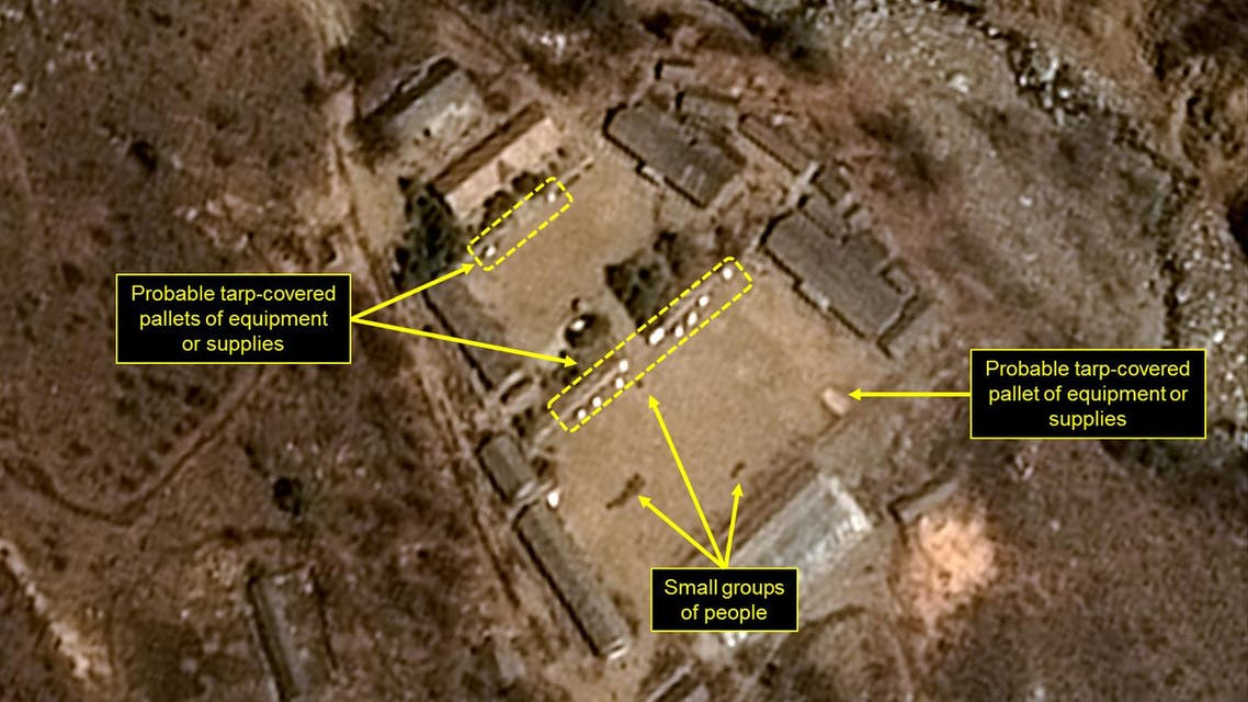 This handout picture obtained on April 13, 2017 from French space agency Centre national d'etudes spatiales (CNES - National Centre for Space Studies), Airbus Defense and Space and the 38 North analysis group, shows a satellite image taken on April 12, 2017 of North Korea's Punggye-ri Nuclear Test Site, with probable tarp-covered pallets and personnel in the Main Administrative Area. North Korea is ready to launch a nuclear test at its Punggye-ri Nuclear Test Site, the 38 North monitoring group reported on April 12, 2017. Commercial satellite imagery of North Korea's Punggye-ri Nuclear Test Site from April 12 shows continued activity around the North Portal, new activity in the Main Administrative Area, and a few personnel around the site's Command Center, the North Korea-related analysis website said.  HO / Airbus Defense & Space and 38 North / AFP
