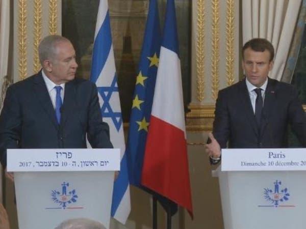 ماكرون بحضور نتنياهو: رفضت قرار ترمب حول القدس