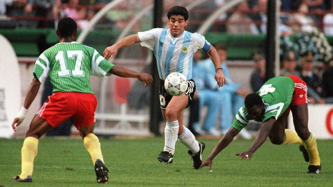 Diego Maradona juggles with the ball as he runs past Cameroon's Benjamin Massing during the World Cup opening soccer match between Cameroon and Argentina June 8, 1990 in Milan. Cameroon upset the defending world champions 1-0. (AFP)