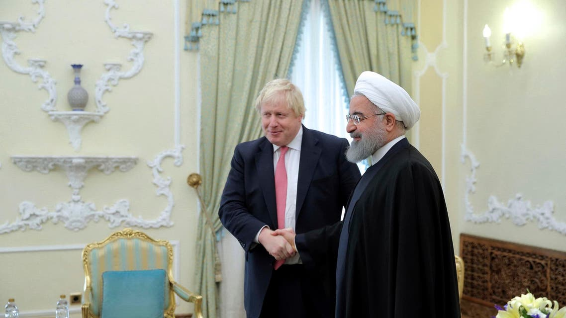Boris Johnson and Iranian President Hassan Rouhani. (AP)