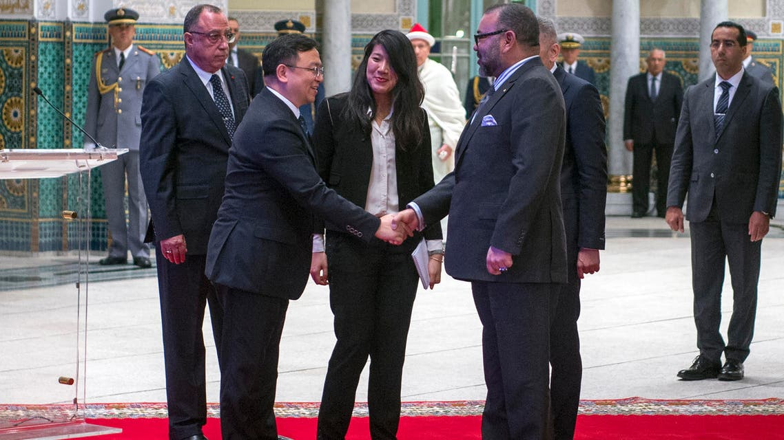 """King Mohammed VI of Morocco greets Wang Chuanfu, the founder of """"BYD auto"""", ahead of the signing ceremony between Morocco and the Chinese automobile manufacturer on December 9, 2017, at the Royal Palace in Casablanca. BYD will become the third car manufacturer, after French manufacturers Renault and Peugeot, to construct cars in the North African state. FADEL SENNA / AFP"""