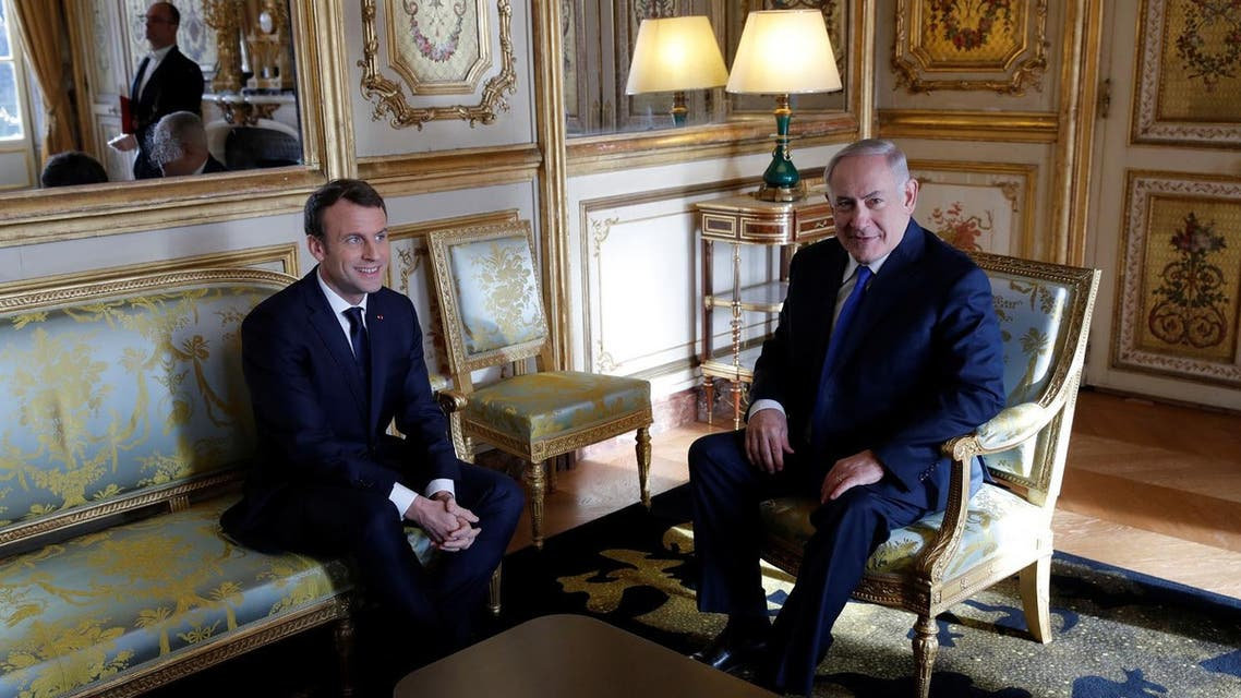 French President Emmanuel Macron speaks with Israeli Prime Minister Benjamin Netanyahu at the Elysee Palace in Paris, France December 10, 2017. (Reuters)