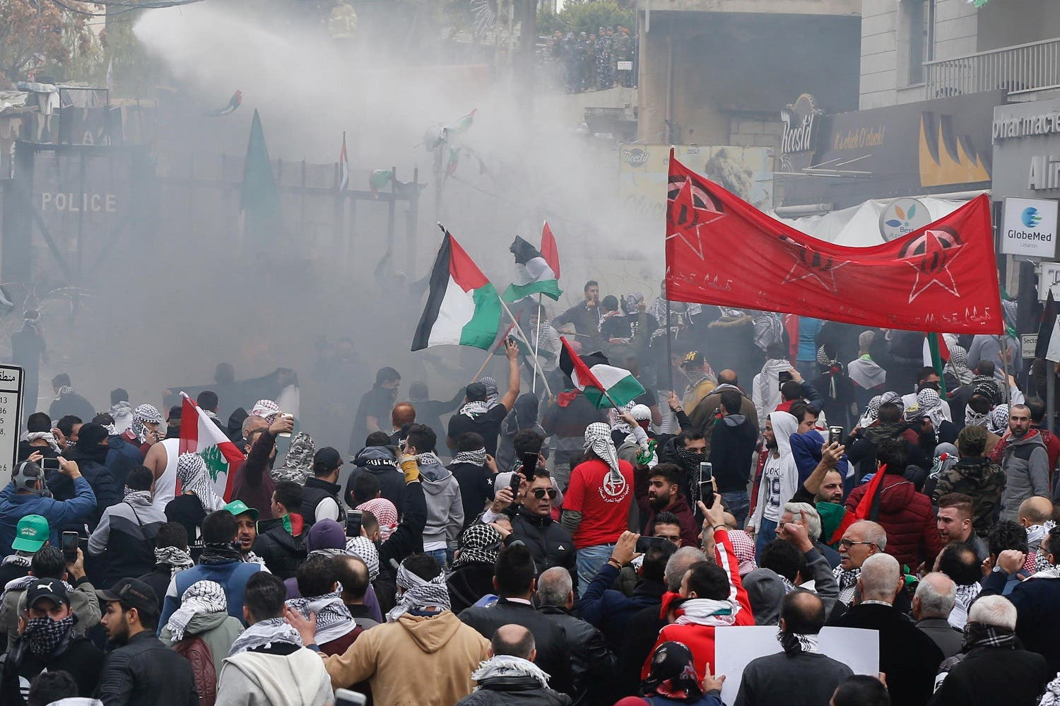Protesters are sprayed with water near the U.S. embassy in Awkar east of Beirut, Lebanon December 10,2017. (Reuters)