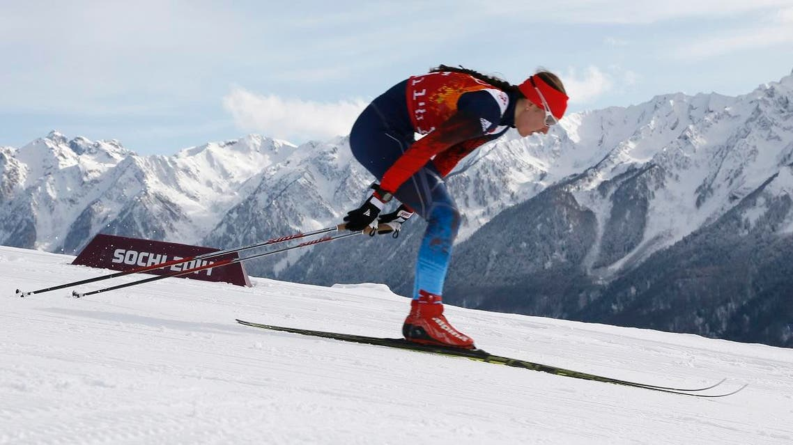 Russia's Anastasia Dotsenko skis during the women's classical-style cross-country team sprint competitions at the 2014 Winter Olympics, Wednesday, Feb. 19, 2014, in Krasnaya Polyana, Russia. (AP)