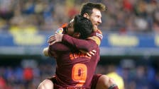 Suarez, Messi give Barca win as Atletico keep up chase