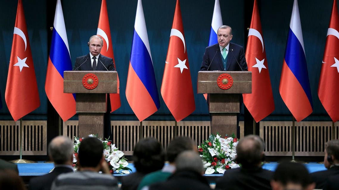 Turkish President Recep Tayyip Erdogan (R) holding a joint press conference with Russian President Vladimir Putin after their meeting at the Presidential Complex. (AFP)