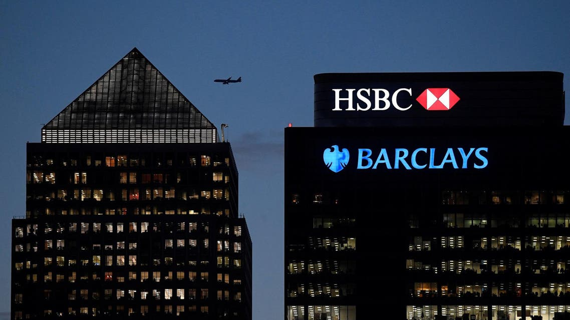 Workers are seen in offices of HSBC and Barclays bank in the Canary Wharf financial district at dusk in London on November 17, 2017. (Reuters)