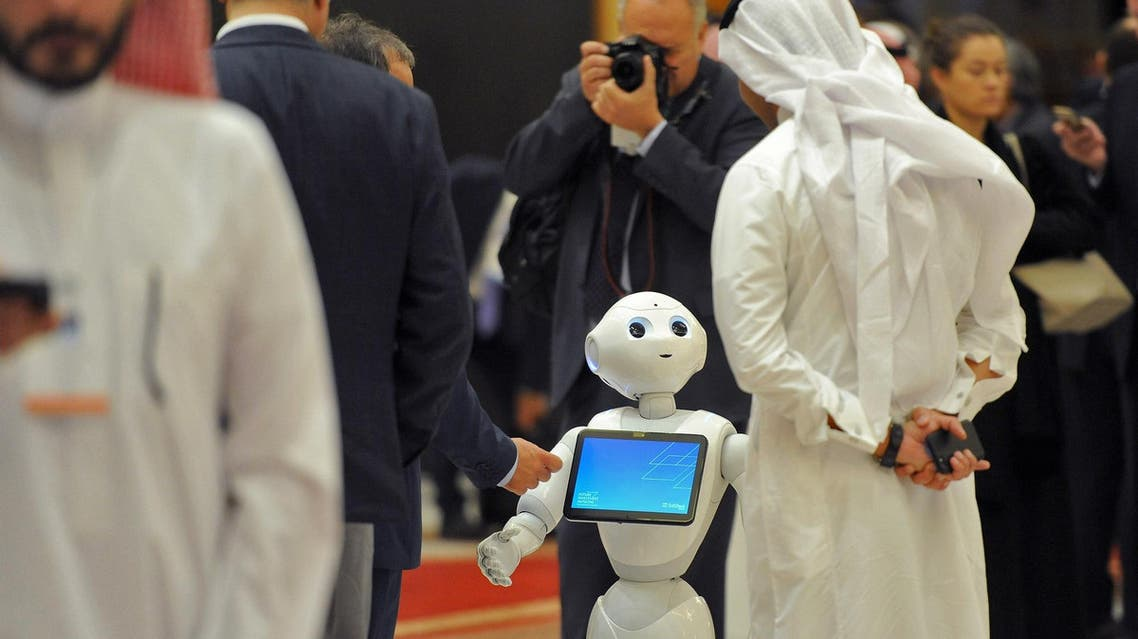 A Saudi man chats with a robot on the sidelines of the Future Investment Initiatives conference in Riyadh, on October 25, 2017. (AFP)