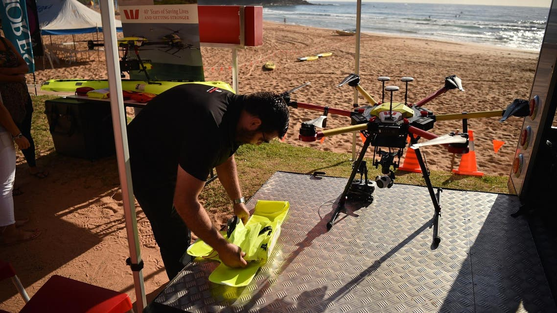 Drone pilot Ben Trollope setting up his shark-spotting drone on Bilgola beach north of Sydney on December 10, 2017. (AFP)