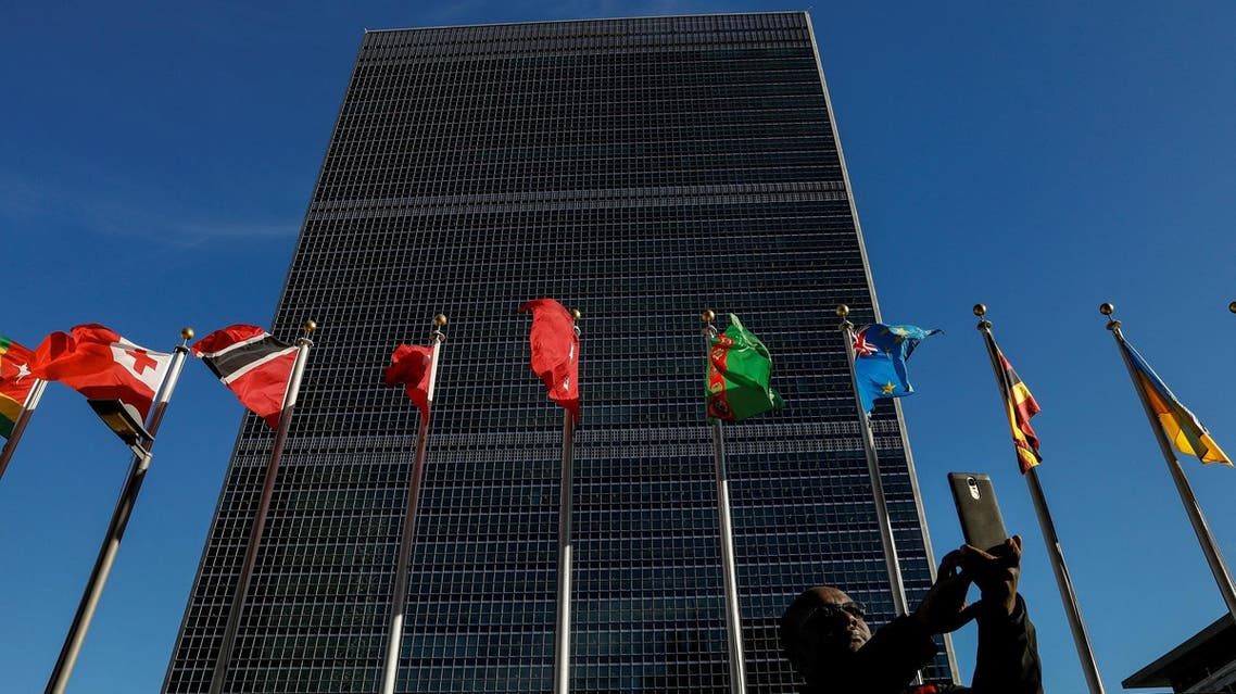 A man takes a selfie in front of the UN Headquarters building in New York City on November 17, 2017. (Reuters)