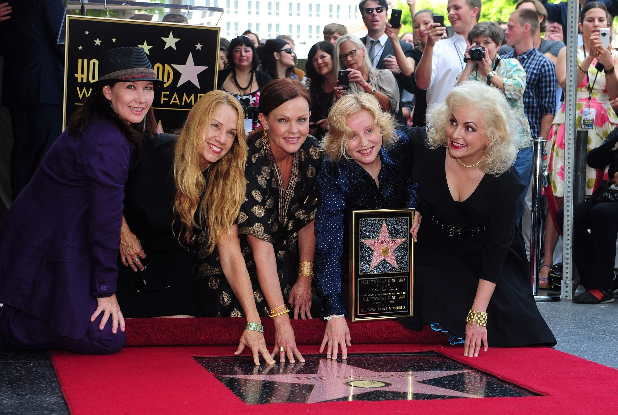 The all-female rock band The Go-Go's pose beside their star on Hollywood's Walk of Fame on August 11, 2011 in Hollywood. (AFP)
