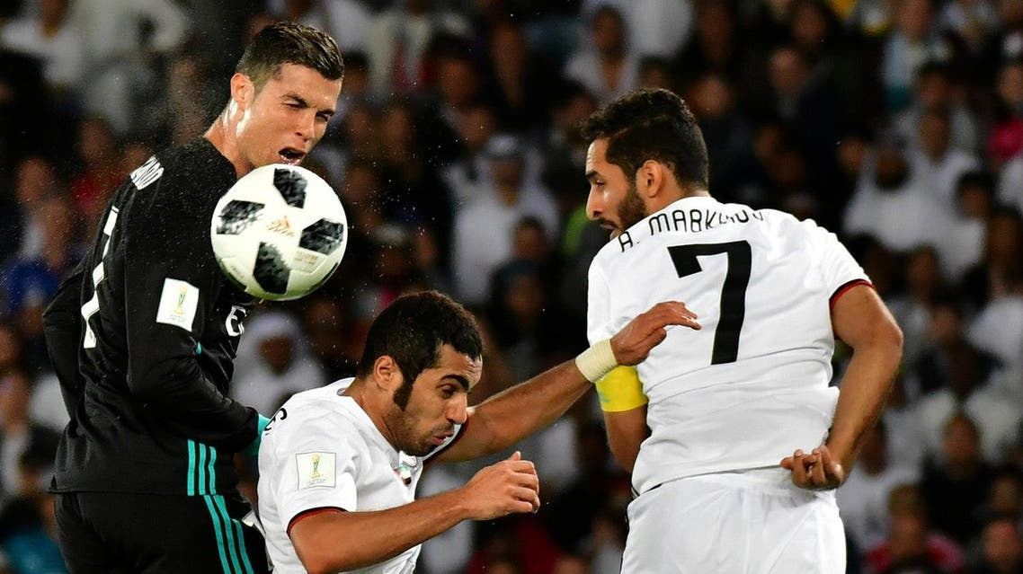 Real Madrid's Portuguese forward Cristiano Ronaldo (left) vies for the header with al-Jazira's Emirati defender Musallem Fayez (center) and Emirati forward Ali Mabkhout (right) during the FIFA Club World Cup semi-final match in the Emirati capital Abu Dhabi on December 13, 2017. (AFP)