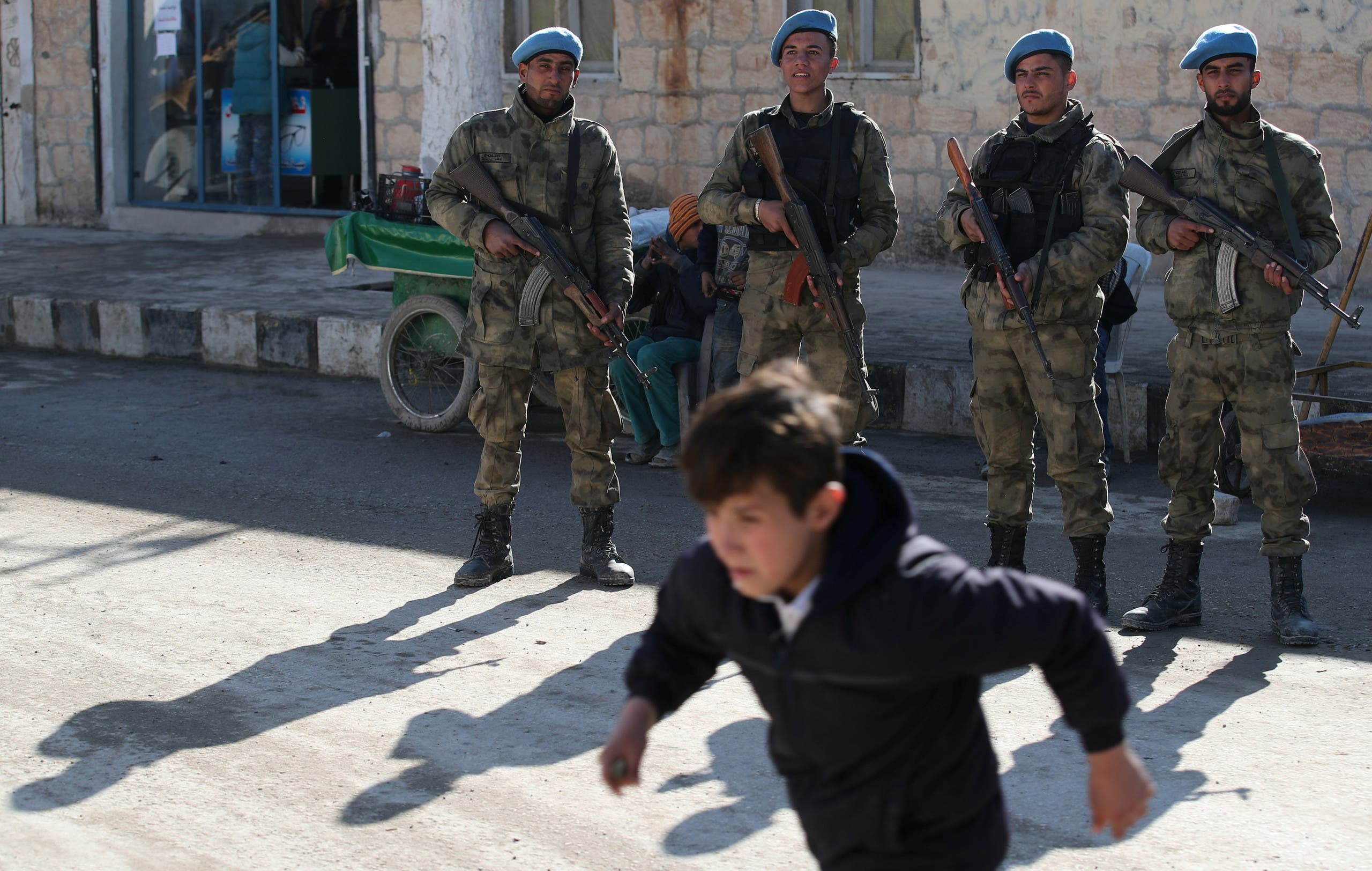 Syrian police officers secure a street in Syrian border town of Jarablus on December 13, 2017. (Reuters)