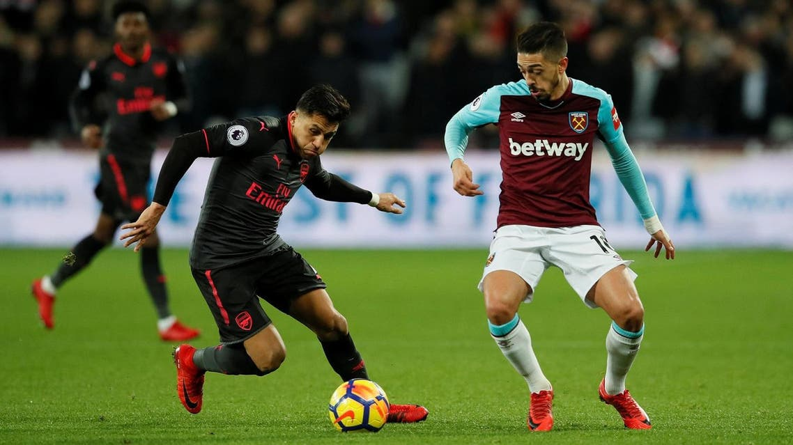 Arsenal's Alexis Sanchez in action with West Ham United's Manuel Lanzini on December 13, 2017. (Reuters)