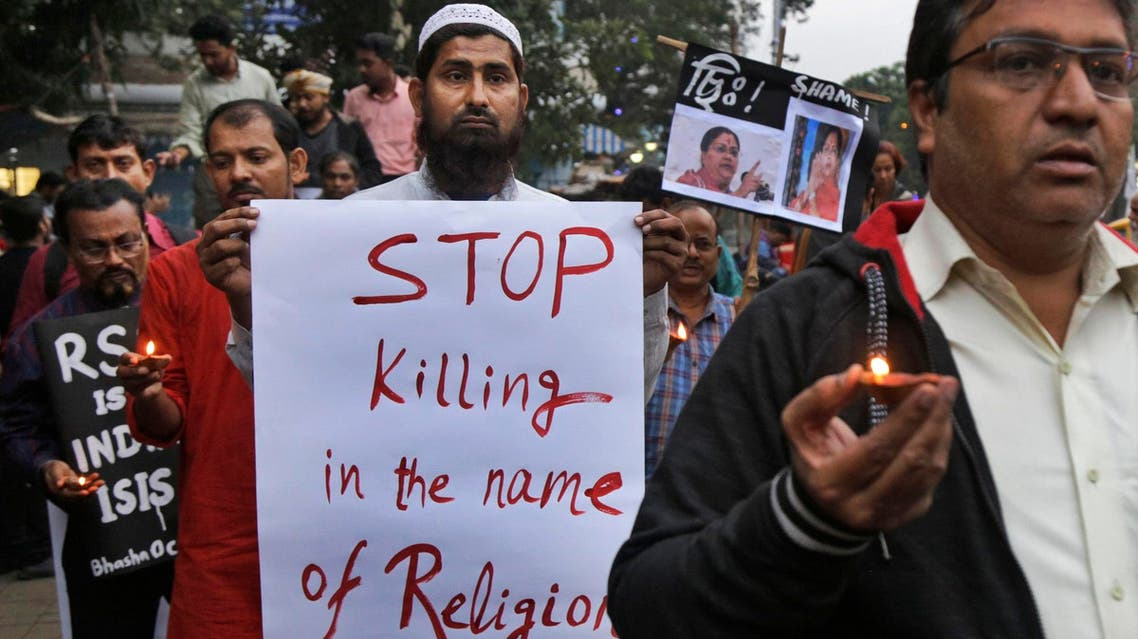 Human rights activists walk during a protest against the reported brutal killing of a Muslim laborer in Kolkata on Dec. 8, 2017. (AP)