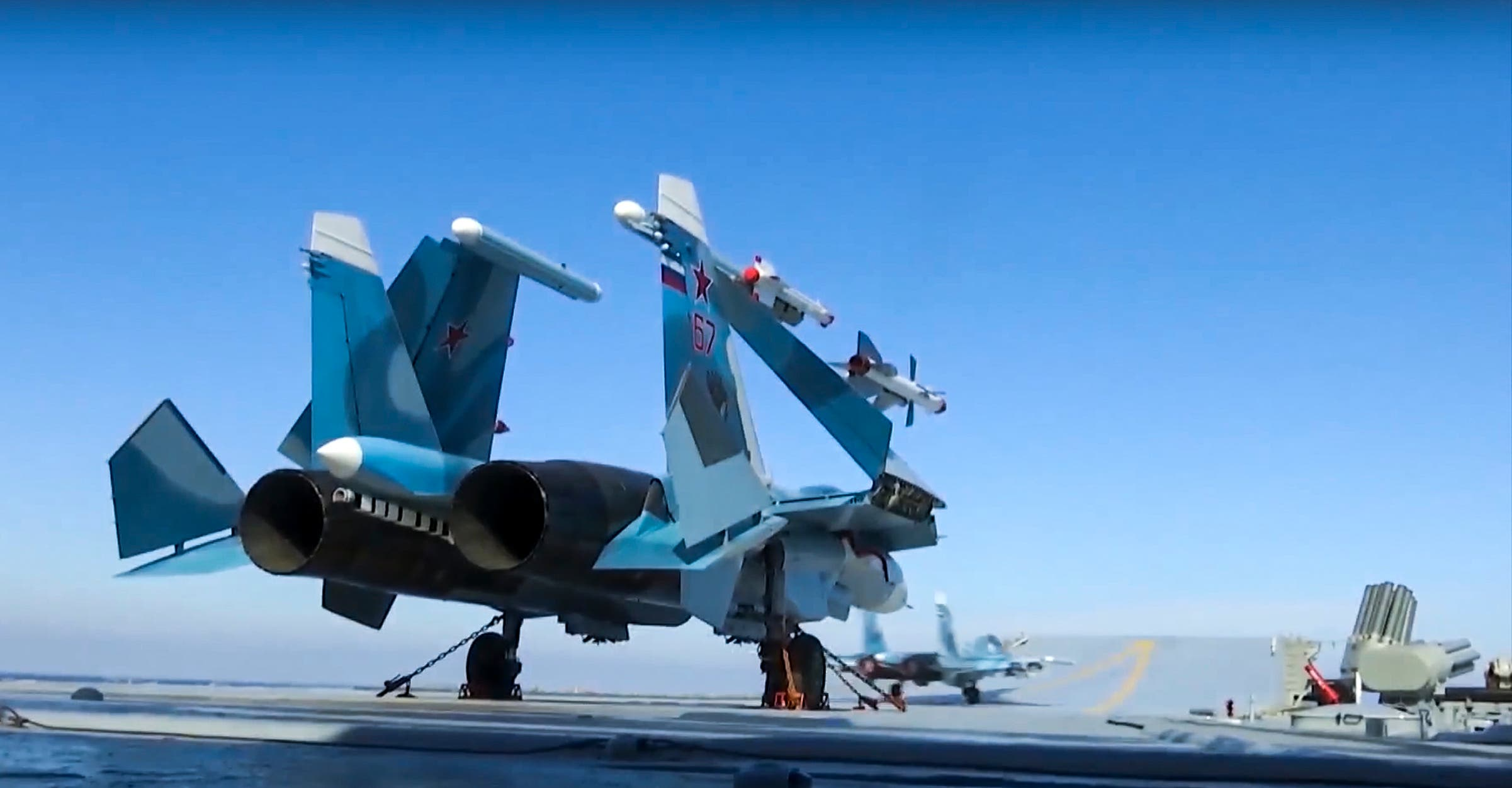 In this photo made from the footage taken from Russian Defense Ministry on Nov. 15, 2016, Russian Su-33 fighter jets are parked on the flight deck of the Admiral Kuznetsov aircraft carrier in the eastern Mediterranean Sea. (AP)