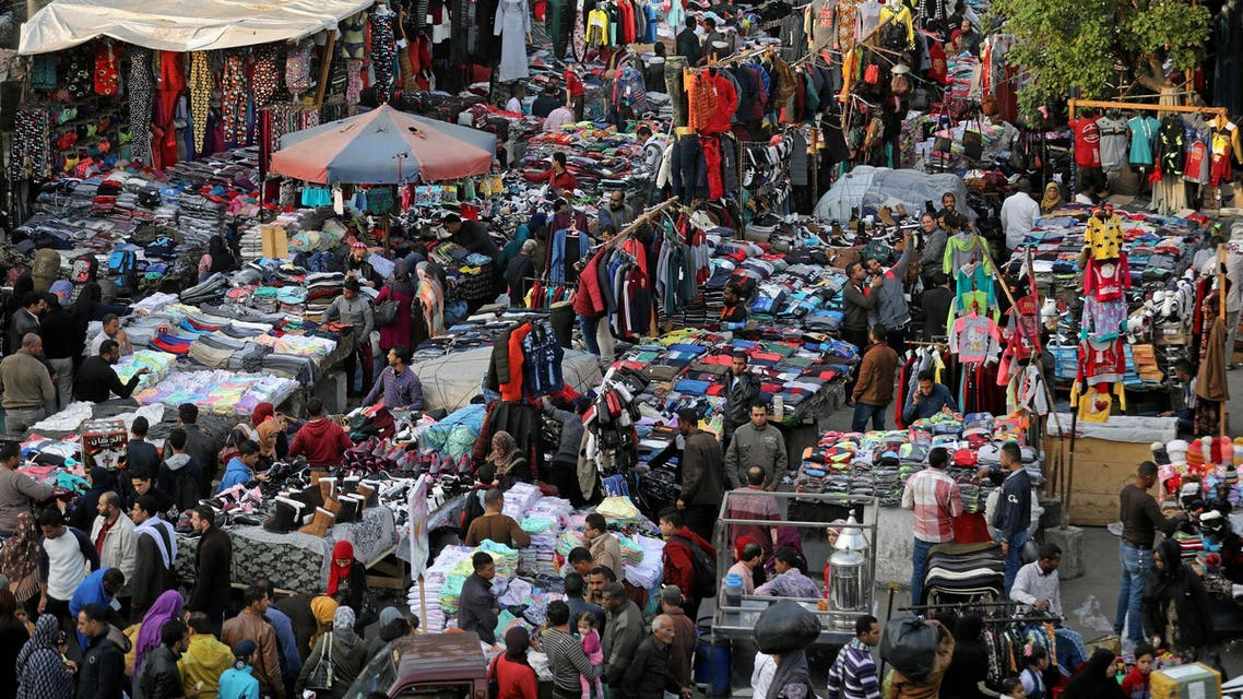 People shop at al-Ataba, a popular market in downtown Cairo, on December 12, 2017. (Reuters)