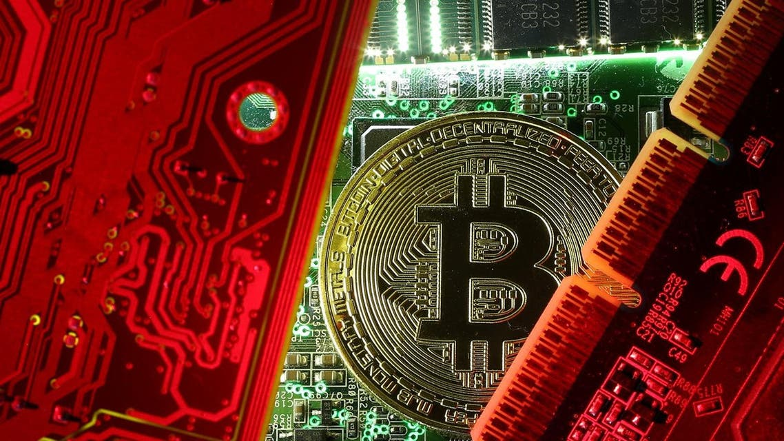 A coin representing the bitcoin cryptocurrency is seen on computer circuit boards in this illustration picture, October 26, 2017. (Reuters)