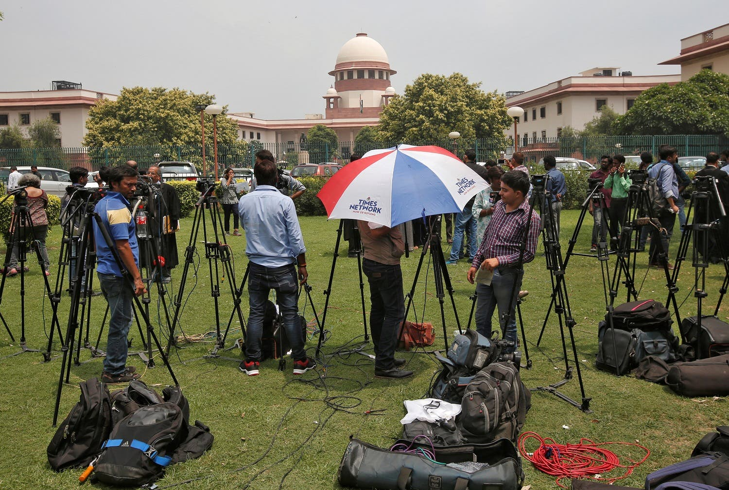 Television journalists outside the premises of the Supreme Court in New Delhi on August 22, 2017. (Reuters)