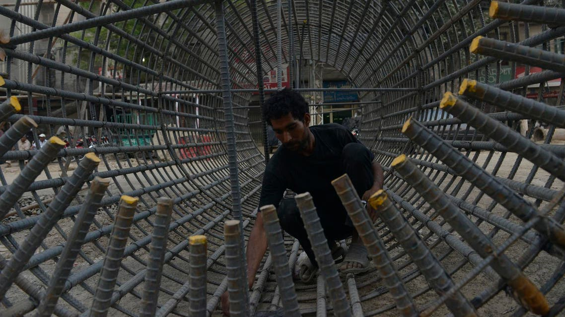 A Pakistani laborer works on a building site in Lahore on May 13, 2016. (AFP)