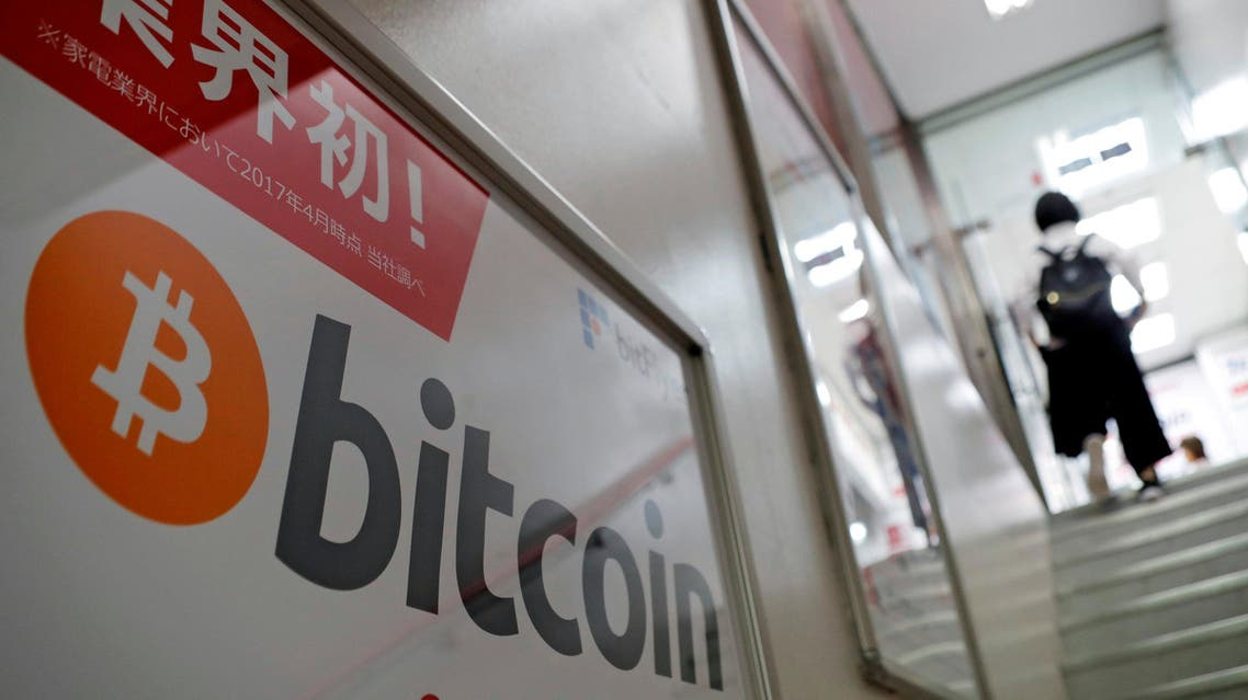 A logo of Bitcoin is seen on an advertisement of an electronic shop in Tokyo on September 5, 2017. (Reuters)