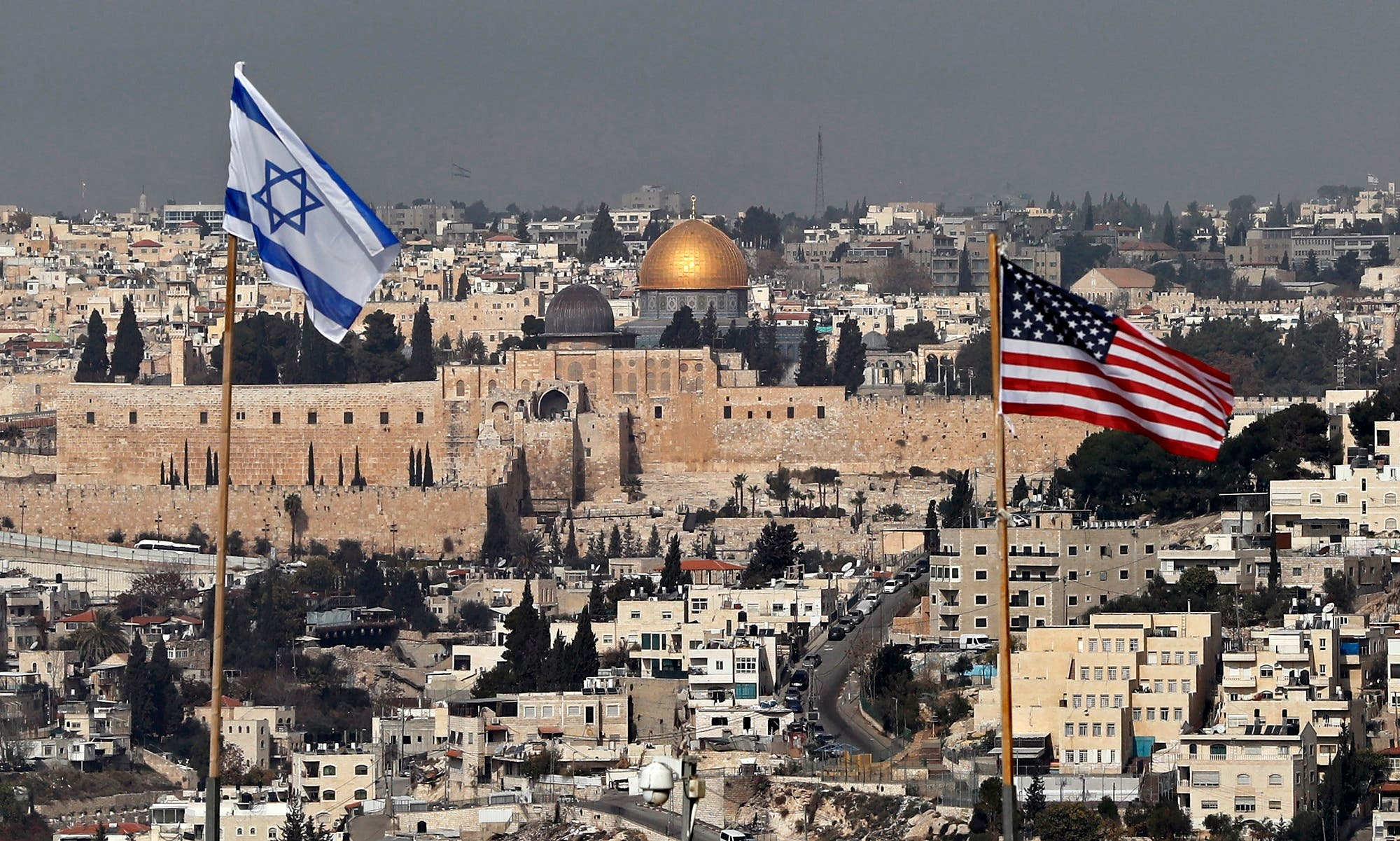 Israeli and US flags placed on the roof of an Israeli settlement building in East Jerusalem on December 13, 2017. (AFP)