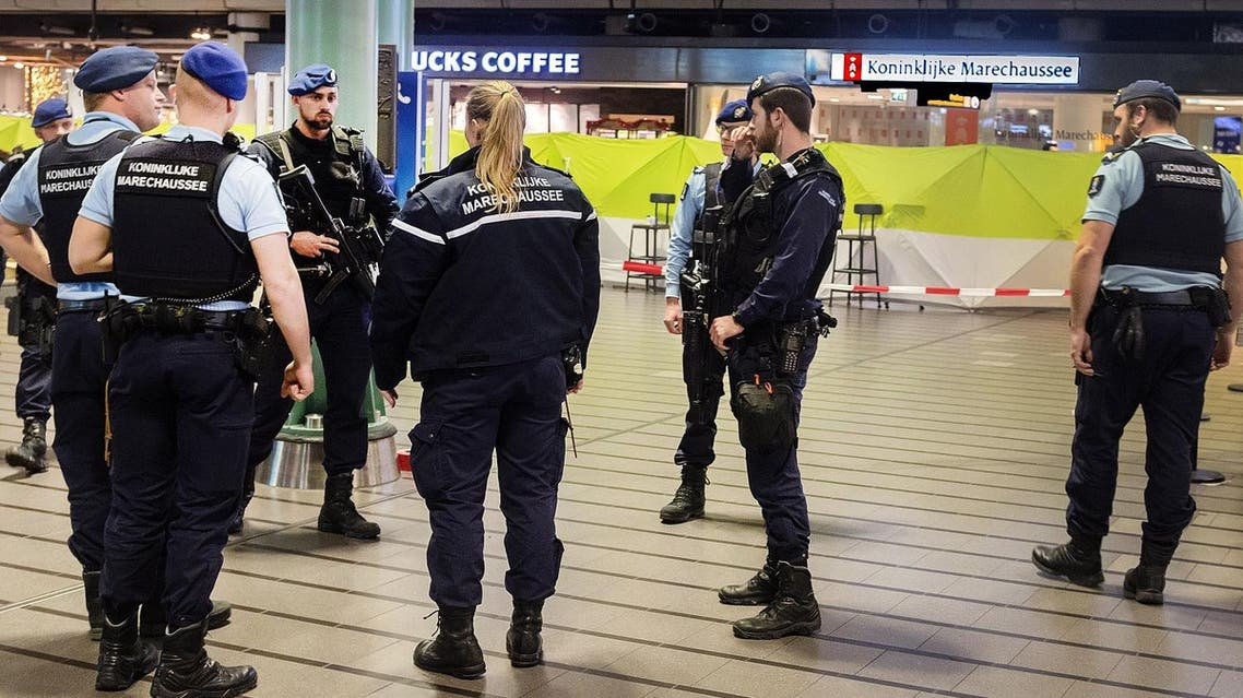 Police patrol after a man wielding a knife was shot by military police on December 15, 2017 at Schiphol Airport in Amsterdam. (AFP)