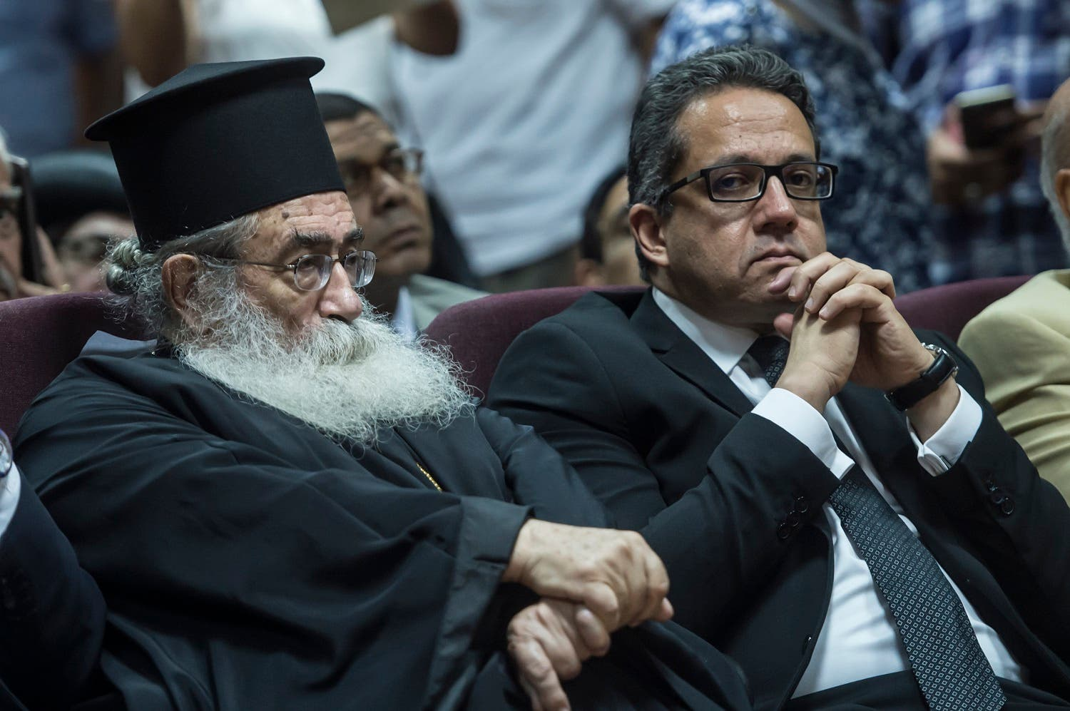 Egyptian Minister of Antiques Khaled el-Anany (R) and Archbishop Damianos of Sinai and Raithu attend a press conference at the Ministry of Antiquities in Cairo on July 4, 2017, to unveil a manuscripts discovered at Saint Catherine Monastery. (AFP)