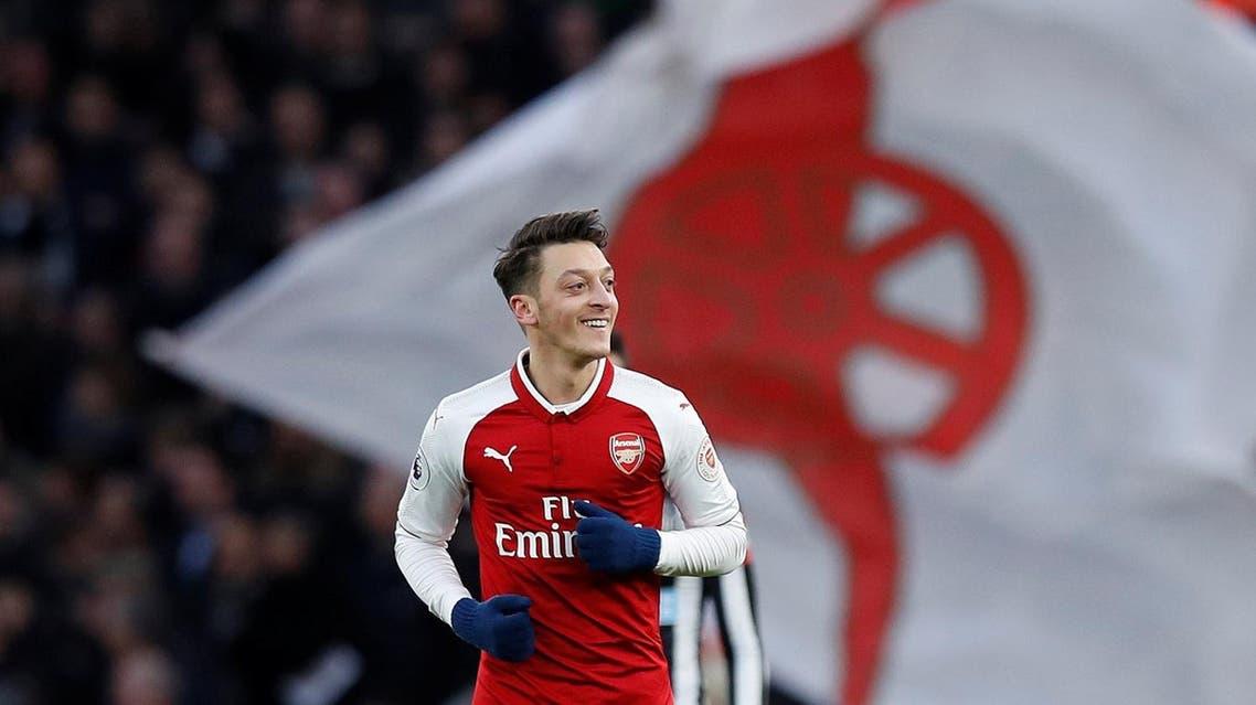 Arsenal's Mesut Ozil celebrates scoring their first goal against Newcastle United. (Reuters)