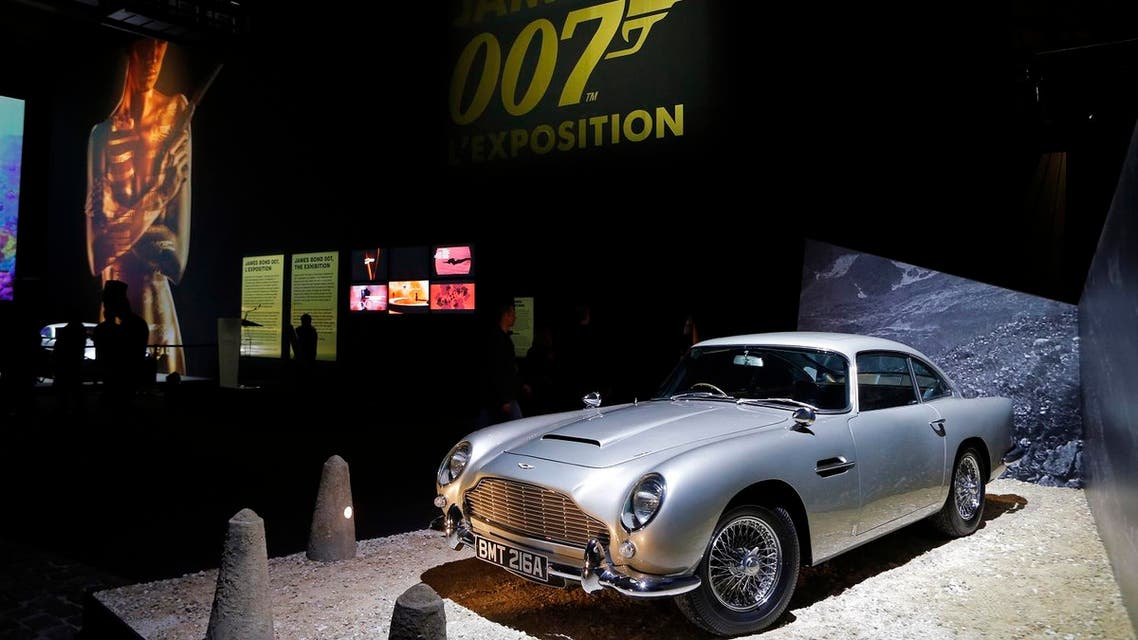 "An Aston Martin DB5 from the James Bond film ""Goldfinger"" is displayed during a press presentation of the exhibition ""The Designing 007: Fifty Years of Bond Style"" at the Grande Halle de la Villette in Paris, France, Wednesday April 13, 2016. (AP)"