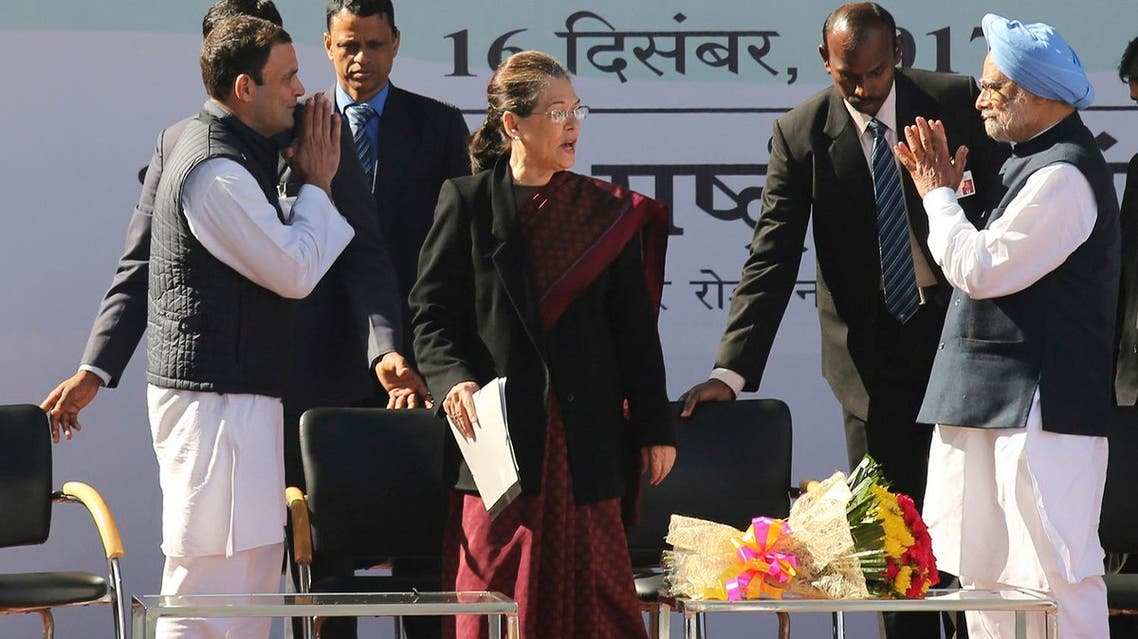 Newly-elected president of the main opposition Congress party Rahul Gandhi, (left), greets former Indian prime minister Manmohan Singh, (right), as former party president Sonia Gandhi watches during a function at the party headquarters in New Delhi. (AP)
