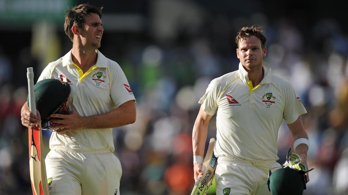 Australian captain Steve Smith (R) and teammate Mitch Marsh (L) leave the field at the end of day three of the third Ashes cricket Test match at the WACA ground in Perth on December 16, 2017. (AFP)