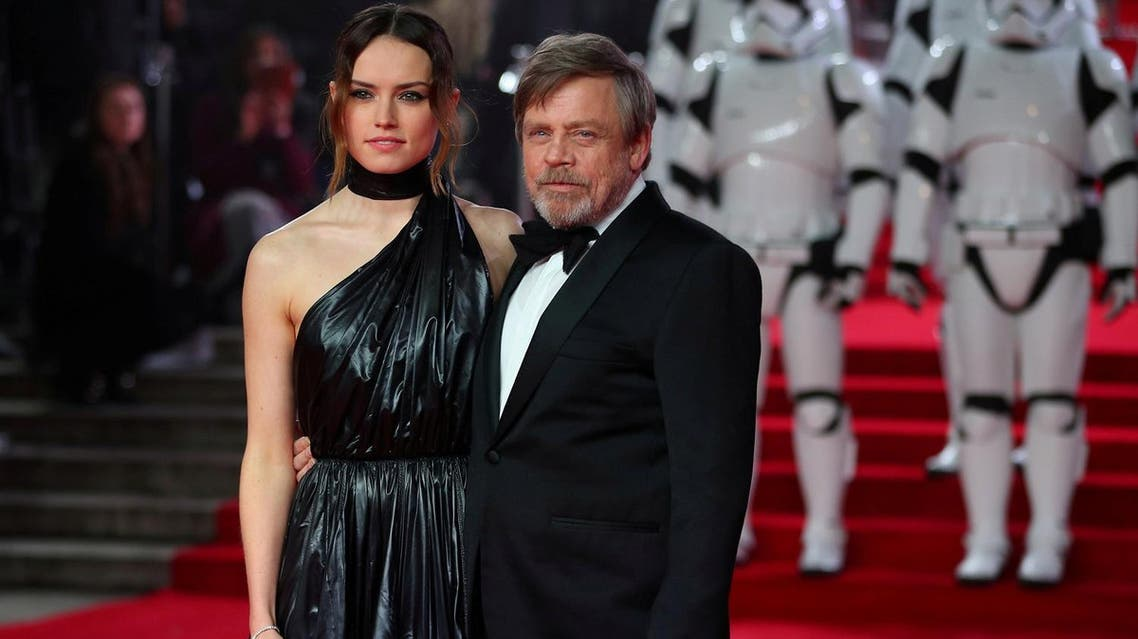 Actors Daisy Ridley and Mark Hamill pose for photographers as they arrive for the European Premiere of 'Star Wars: The Last Jedi', at the Royal Albert Hall in central London, on December 12, 2017. (Reuters)