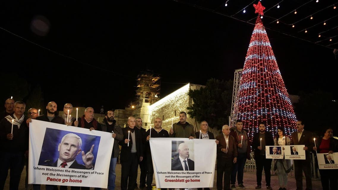 Palestinians hold posters showing US Vice President Mike Pence during a protests against his visit near the Church of the Nativity in the West Bank city of Bethlehem, on Dec. 17, 2017. (AP)