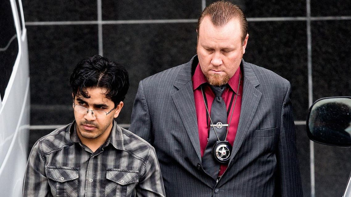 Omar Faraj Saeed Al Hardan, left, is escorted by U.S. Marshals from the Bob Casey Federal Courthouse, in Houston. (AP)