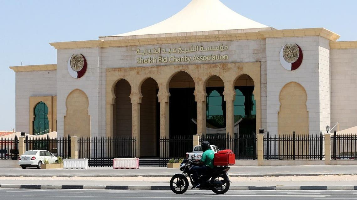 A motorbike drives past the Sheikh Eid Charity Association in the Qatari capital, Doha, on June 9, 2017. (AFP)