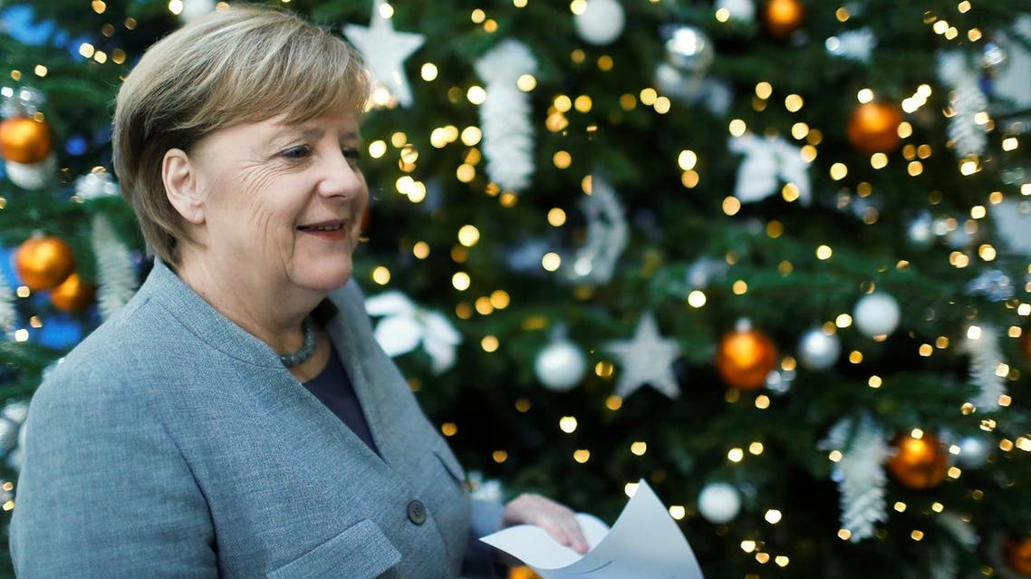 Acting German Chancellor Angela Merkel leaves after a news conference at the Christian Democratic Union (CDU) party headquarters in Berlin, Germany, December 18, 2017. (Reuters)