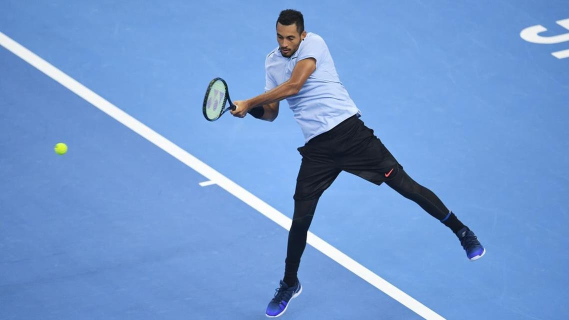Nick Kyrgios of Australia hits a return during the men's singles final against Rafael Nadal of Spain at the China Open tennis tournament in Beijing on October 8, 2017. (AFP)