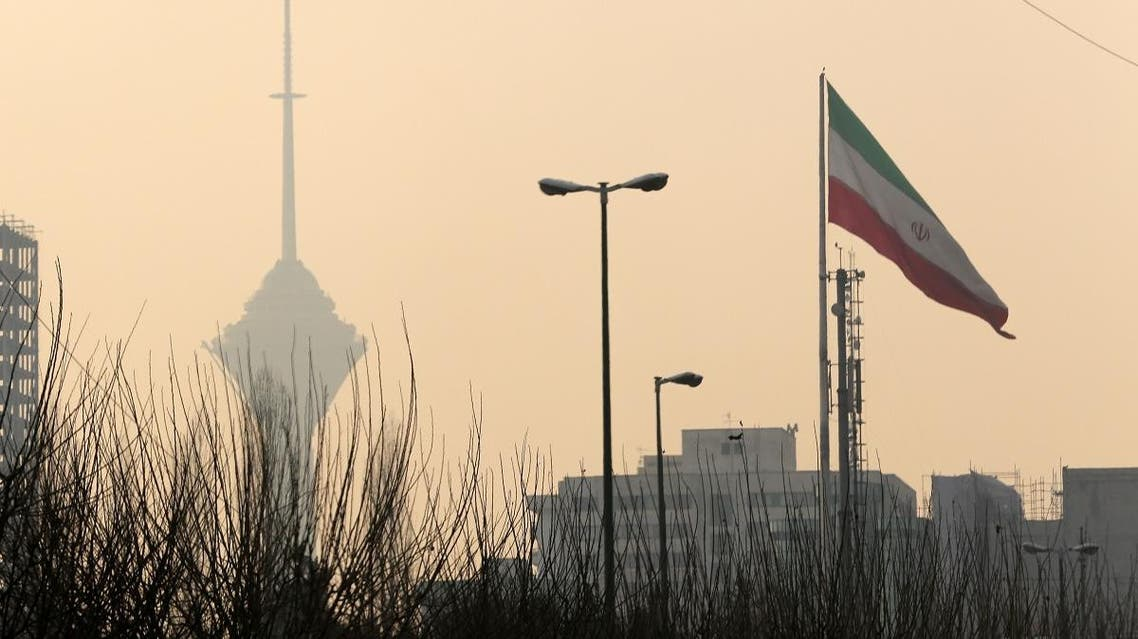 A general view of the Milad telecommunication tower (background-L) engulfed by smog in the Iranian capital Tehran on December 19, 2015. (AFP)
