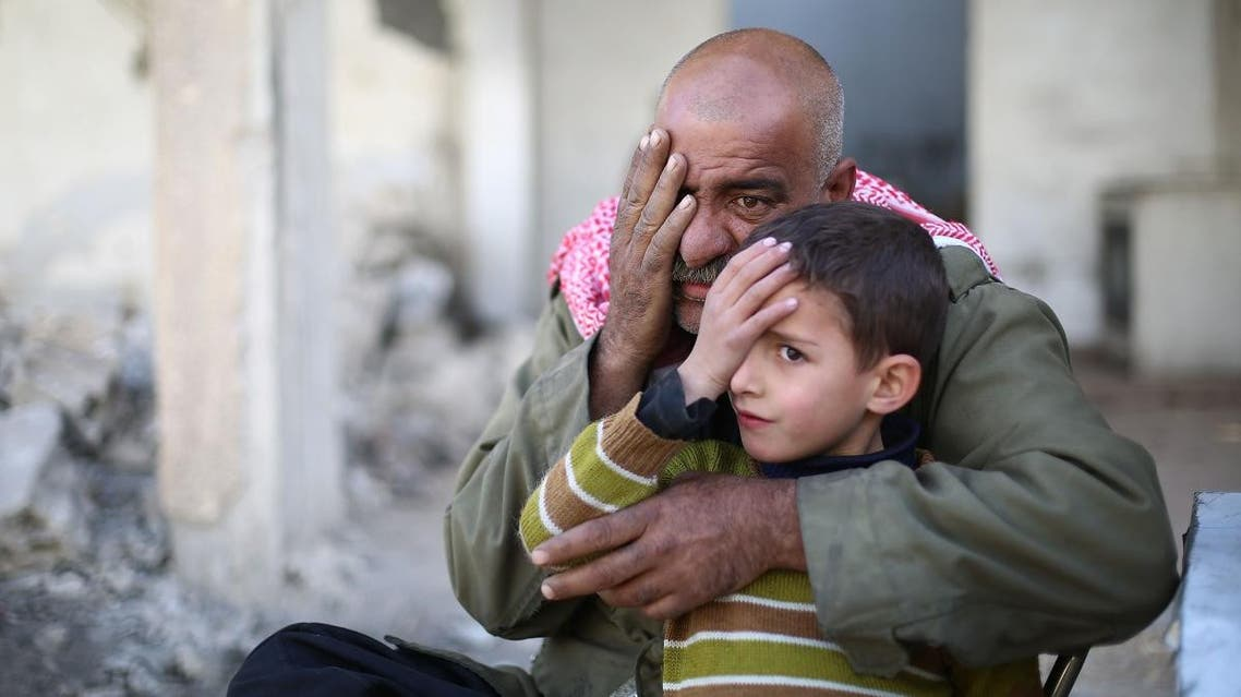 Syrians pose covering one eye with their hands in the rebel-held town of Douma in Syria's besieged eastern Ghouta region. (AFP)