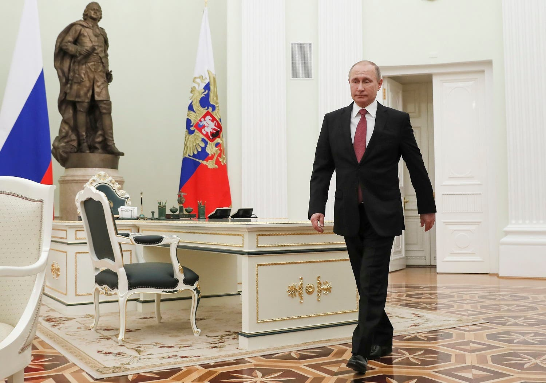 Russian President Vladimir Putin enters a hall to meet Serbian President Aleksandar Vucic during prior to their talks in the Kremlin in Moscow, on Dec. 19, 2017. (AP)