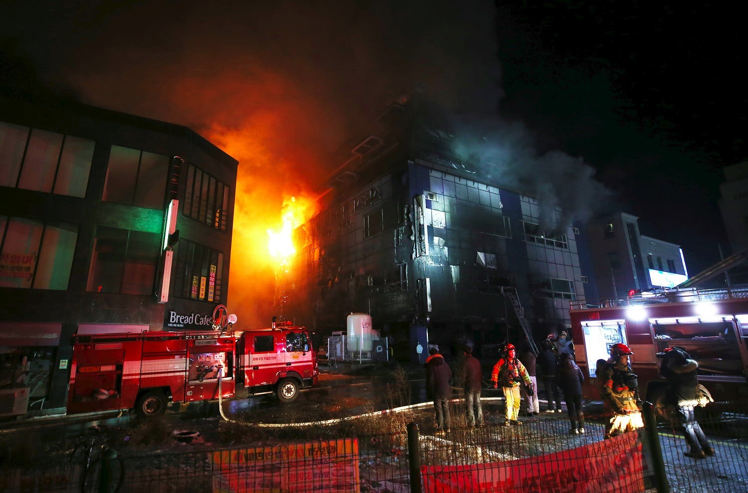 lames and smoke billow from an eight-storey building after a fire broke out in Jecheon, 120 kilometers southeast of Seoul, on December 21, 2017. (AFP)