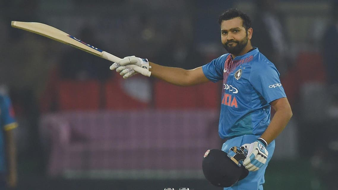Indian captain Rohit Sharma celebrates after scoring his century during the second T20 international cricket match between India and Sri Lanka at the Holkar Stadium in Indore on December 22, 2017.  ( AFP)